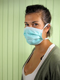 Girl wearing green surgical mask.