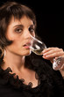 Attractive young woman drinking champagne