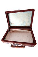 dusty open brown leather suitcase