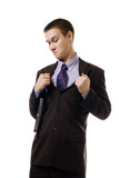 Young man in formal suit tear it apart because of wrong size poster