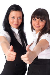Two young women showing success handsign