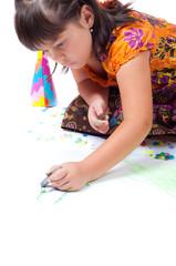 girl laying and drawing