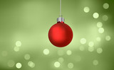Red Christmas Bauble On Blurry Defocussed Lights poster