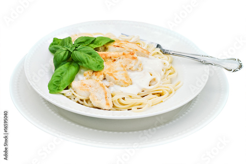 Chicken alfredo with basil isolated on white with clipping path