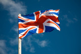 Great Britain flag against blue sky poster
