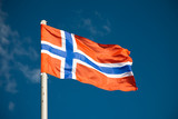 Norwegian flag against blue sky poster