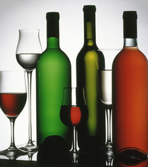 Three wine bottle and several glasses