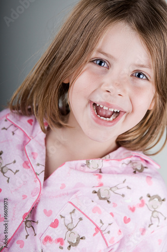 Shot of a Happy Child in her Pyjamas