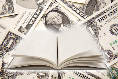 Open book and U.S. currency