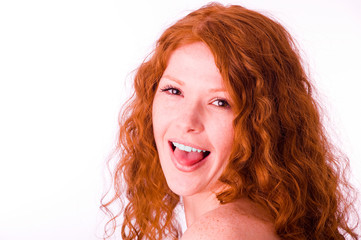 Redheaded girl showing her tongue