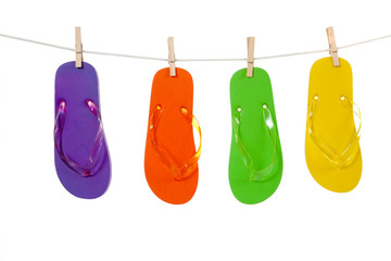 Colorful flip-flop sandles on a Clothesline