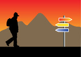 silhouette with backpack with a mountain and a road sign