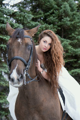 Girl in a white dress on a horse