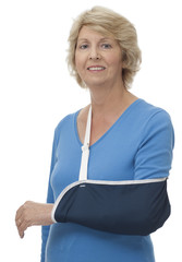 Senior woman with injured arm in sling