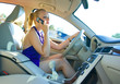 blonde woman driving and talking to mobile phone