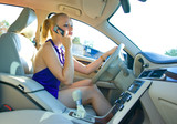 blonde woman driving and talking to mobile phone poster