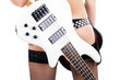 Quadro Sexual blonde and a white bass guitar
