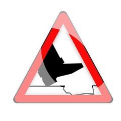 segnale di pericolo buca
