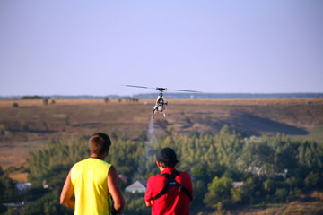 Two guys compete on radio controlled helicopter