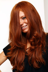 Portrait of girl with beautiful red hair