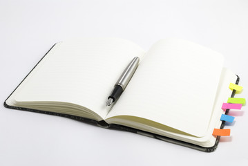 Blank notebook with silver pen