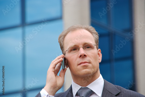 Businessman on the phone outside