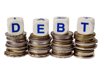 Stacks of coins with the word DEBT isolated on white background