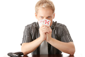 Young poker player with gun