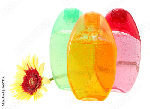 Shower gels and gerbera, isolated.