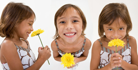 A lovely child holds a yellow flower
