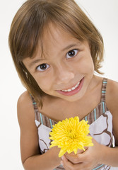 An innocent child holds a single yellow flower
