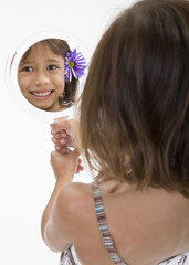 A Mirror Reflection of a Young Girl