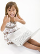 A young girl playing on her laptop