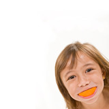 A Young Girl with an Orange Smile