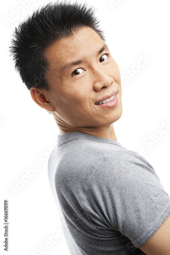 Asian young man looking at camera