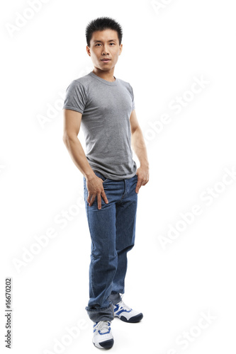 Full body pose of young fitness Asian man