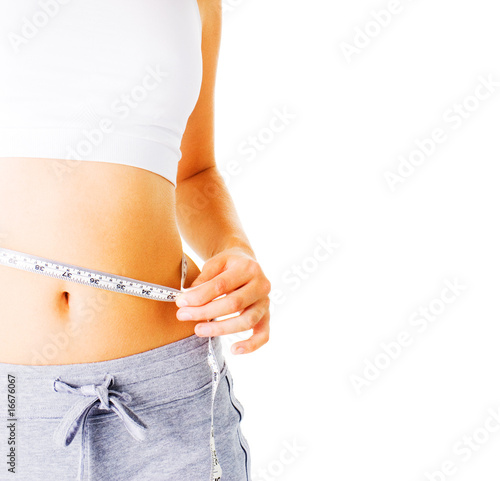 Young Woman Measuring Herself On White
