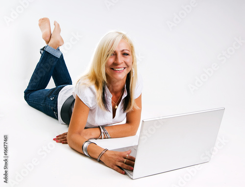 Business Woman lying on the floor in front of a laptop