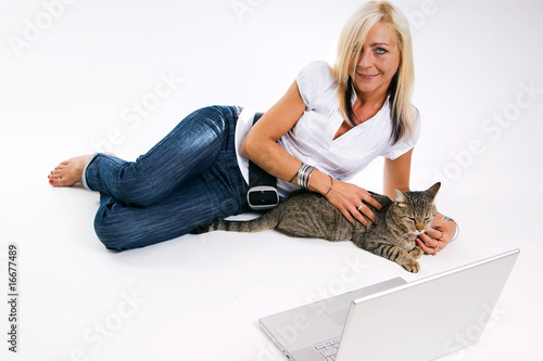 Business Woman lying  in front of a laptop with a cat
