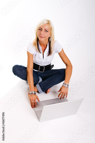 Successful and happy woman with a laptop