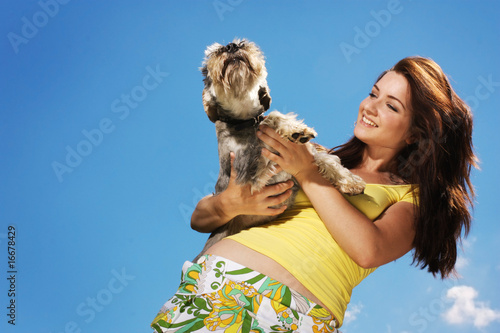 Beautiful girl and her dog