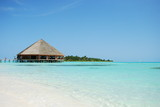Fototapety Bungalow's architecture and beach on a Maldivian Island