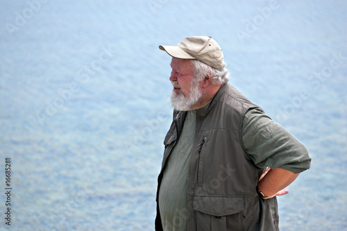 Photo: Senior man with water in background