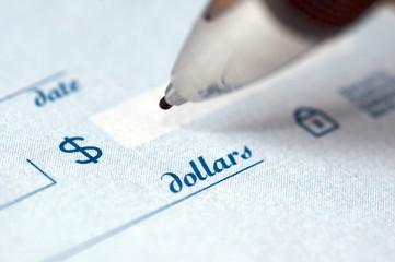 Close up on a pen writing a check