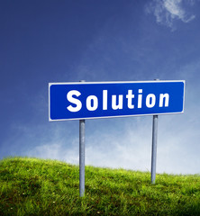solution single in board with green grass and blue sky