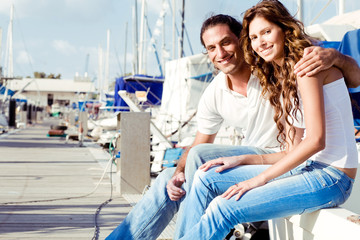 Smiling couple at boat harbour