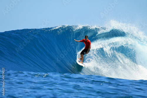 Surfer riding perfect tropical blue wave, Mentawai, Indonesia
