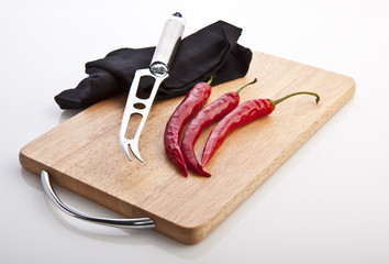 Red hot chili peppers on cutting board