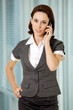 Portrait of young caucasian businesswoman talking on cellphone i