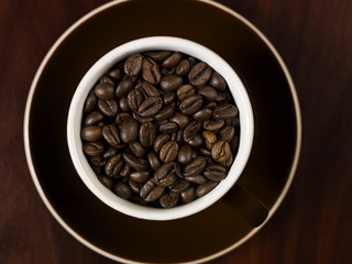 High angle view of coffee beans in a cup.